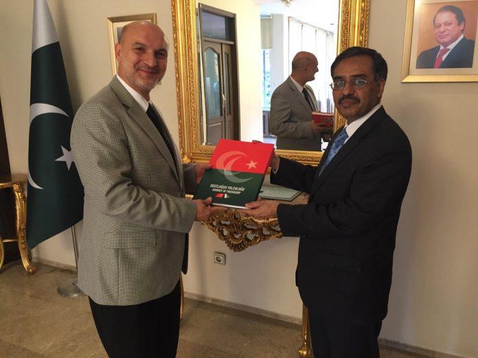Ambassador Sohail Mahmood presenting a book to President of DEIK